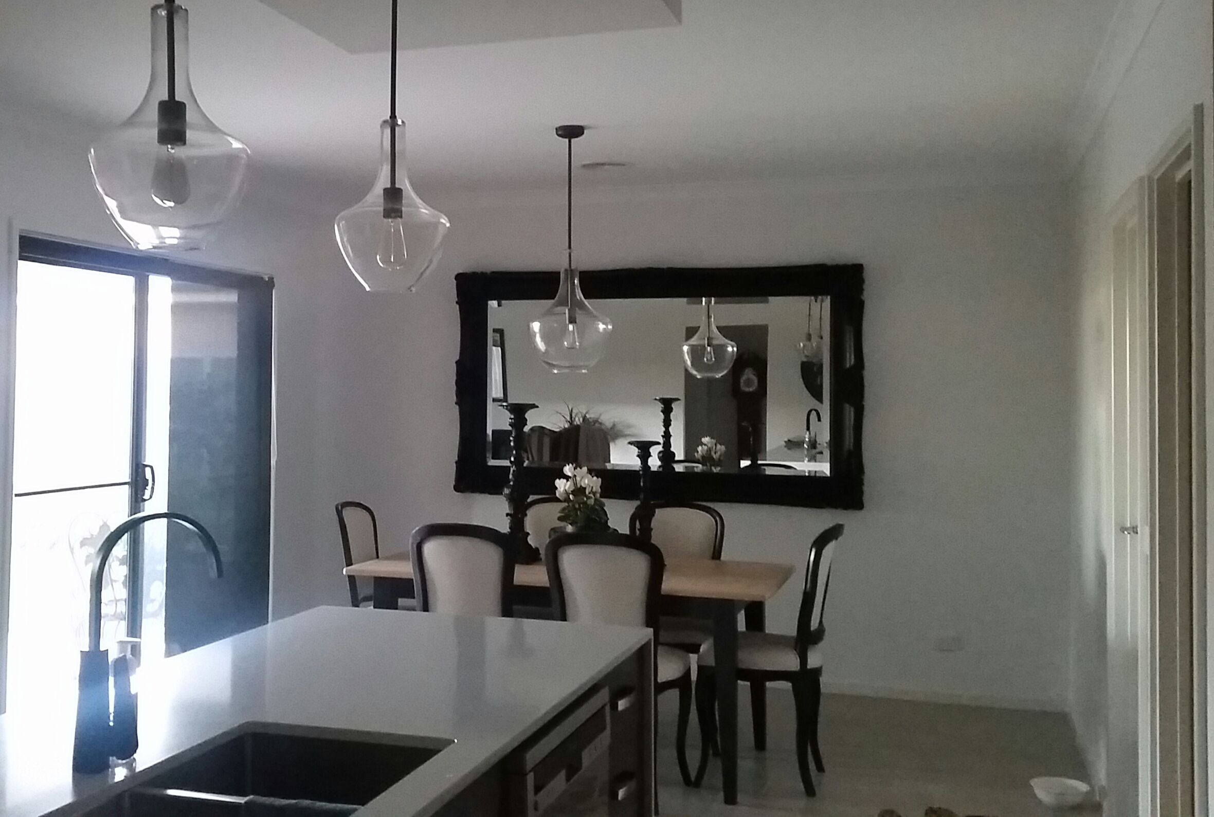 Old Bronze/Glass pendants featured over bench and dining table